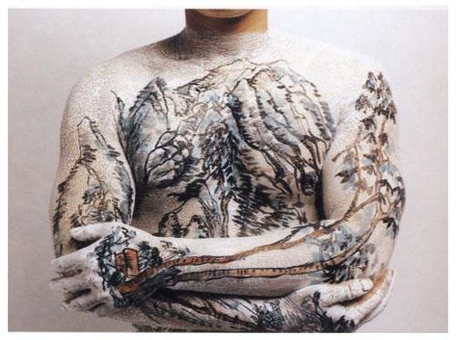 these photos of a man with a Chinese landscape painting tattooed on his