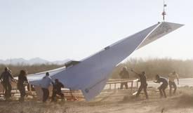 la-fi-tn-45-foot-paper-airplane-glides-o